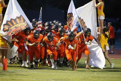 Corona Del Sol Football players entering the field