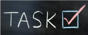 Word Task on chalkboard with a check mark
