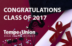 Congratulations Class of 2017 on red background with diplomas, cap, and confetti