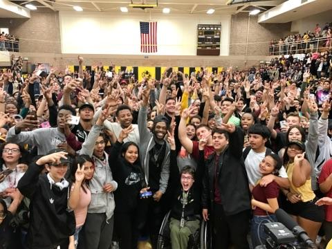Rapper Sincerely Collins poses with MDN students